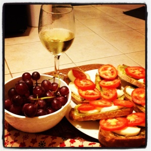 Rosemary Ciabatta bread from Texas French Bread Co. topped with yummy mozzarella, pesto and roma tomatoes alongside grapes and WINE!